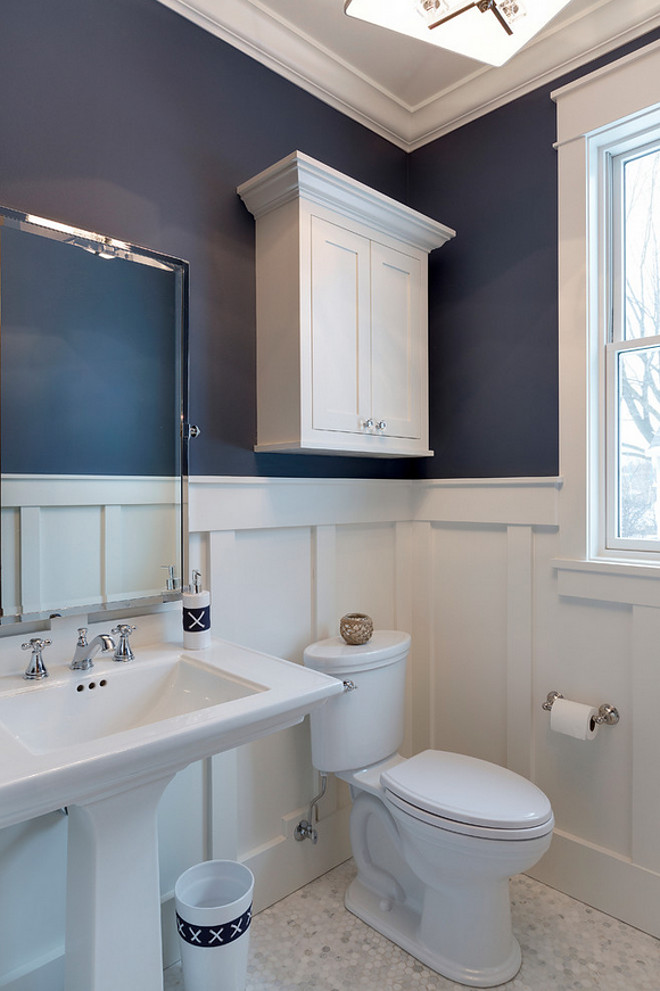 Alternatively, this bathroom shows White Dove pairing with a navy blue. The navy's gray undertones are brought out by the gray in the White Dove.