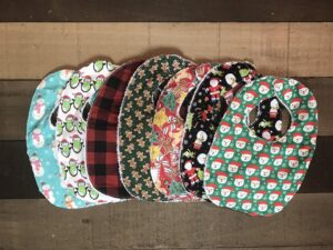 Custom patterns for baby's first Christmas bibs