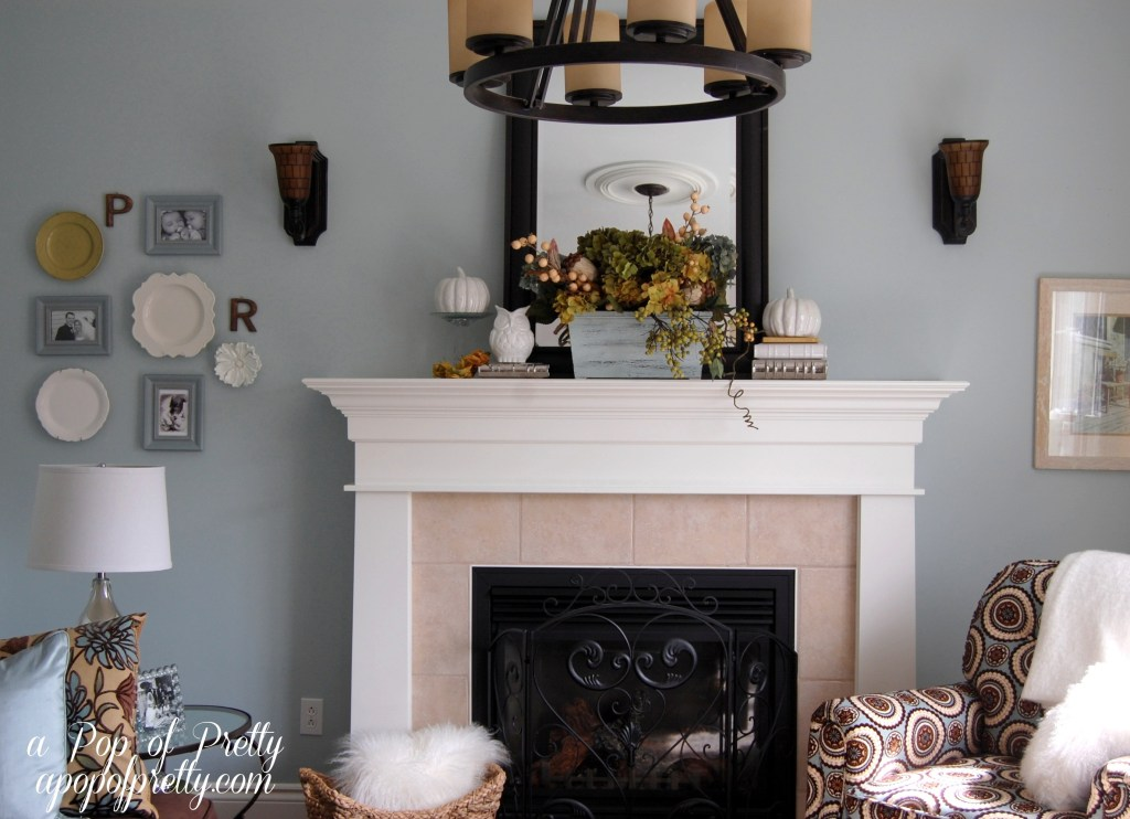 white, purple and gold fall mantel