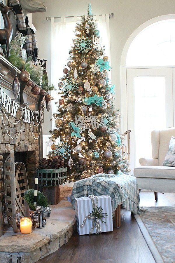 Teal and rustic Christmas tree in a living room