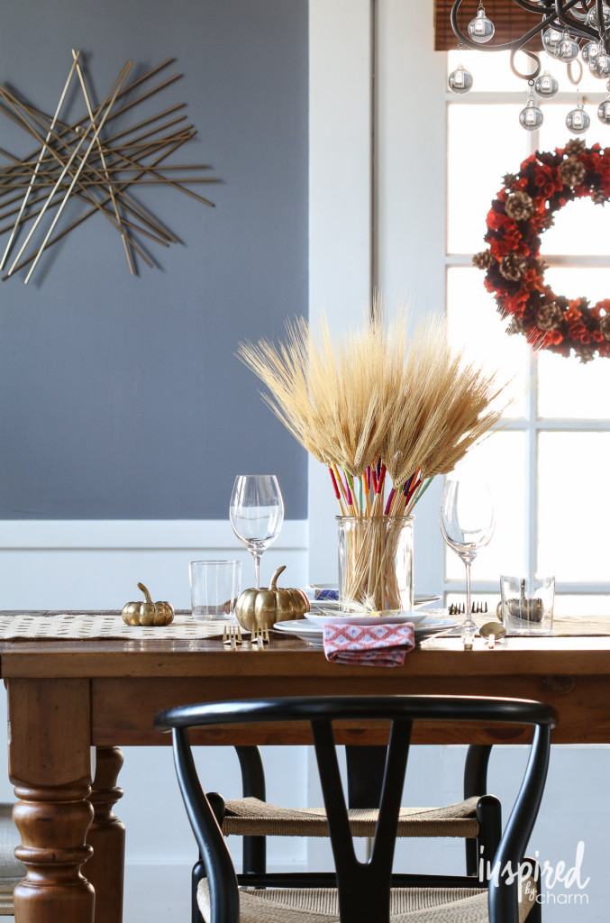 Thanksgiving table decor ideas- Fun modern wheat centerpiece takes the stage on this Thanksgiving dinner table