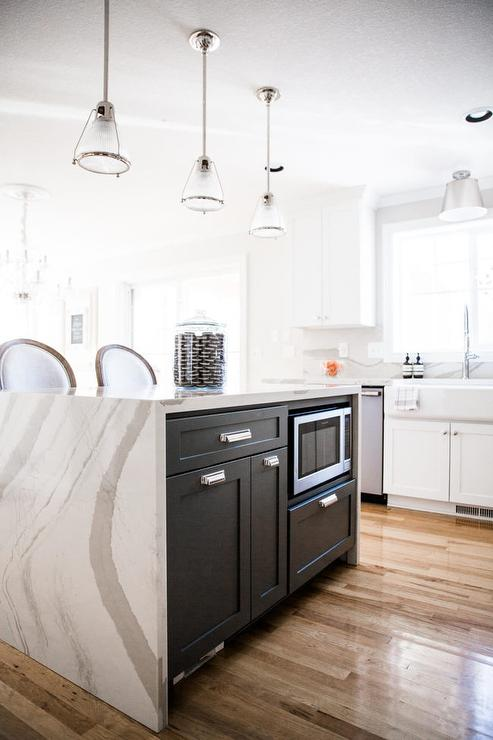 Kendall Charcoal kitchen cabinets with gorgeous quartz waterfall countertops