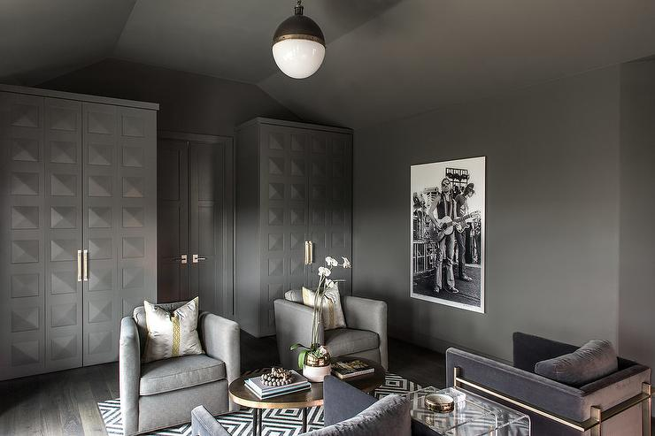 Masculine gray den with kendall charcoal paint on the walls