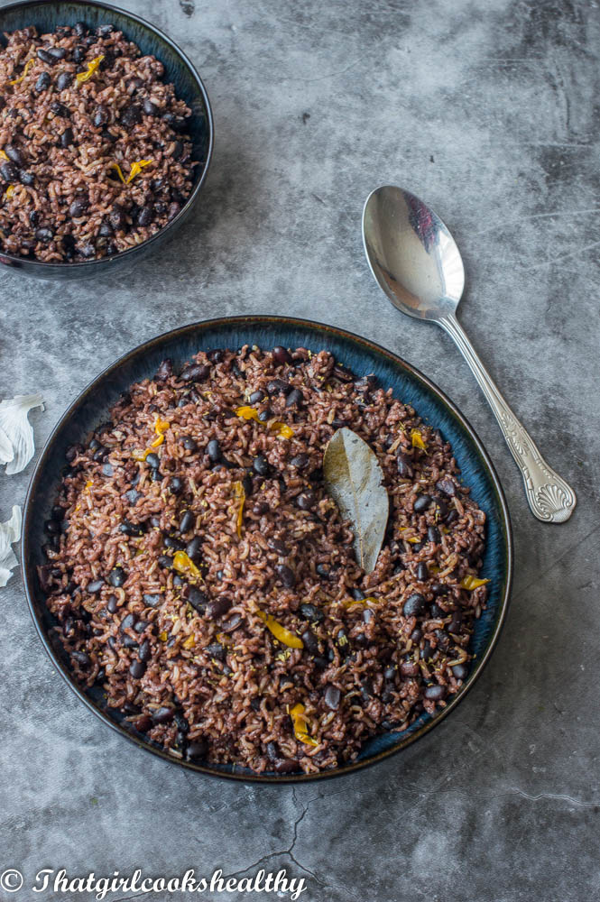 Bowl of black beans and rice on a gray background