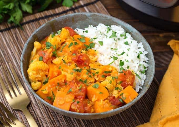 Vegan curry veggies from the instant pot served in a bowl with rice